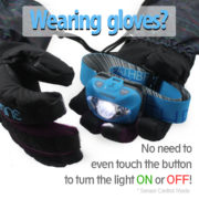 blue-headlamp-on-the-gloved-hand