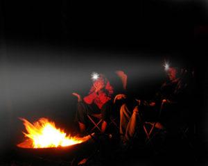 men-sitting-beside-campfire